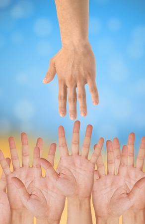 hands of help over bright background photo