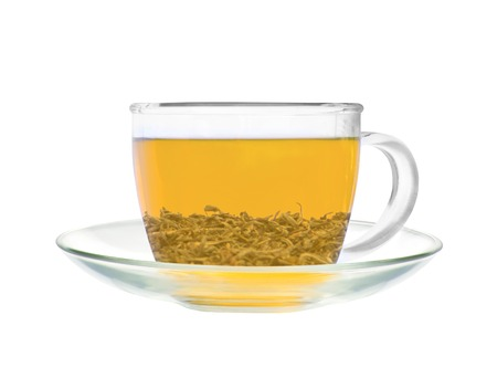 Transparent cup of green tea isolated on white background photo