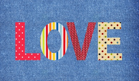 Textile letter love over jeans background photo