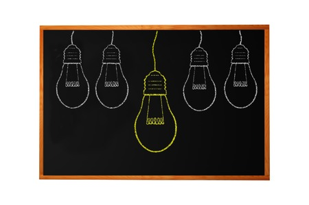 Blackboard with drawing light bulb closeup photo
