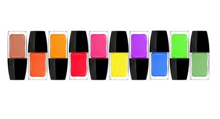 set of colorful nail polishes isolated on white background photo