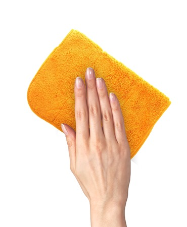 Hand wiping surface with orange rag isolated on white Stock Photo - 27014665