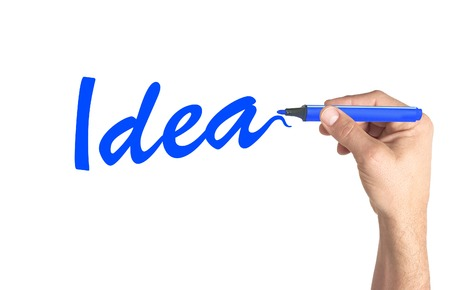 Hand writing word Idea on transparent board photo