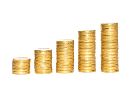 Savings, increasing columns of gold coins over white background photo