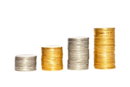 Savings, increasing columns of gold and silver coins isolated on white background photo
