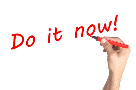 Hand writing Do it now on transparent board