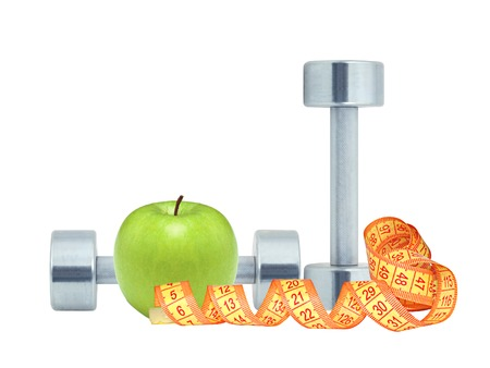 Chromed fitness dumbbells, measure tape and green apple isolated on white background photo