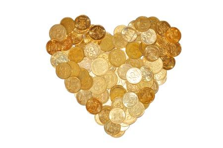 many coins like heart symbol isolated on white background photo