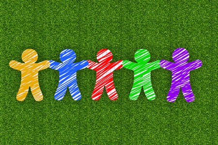 Paper people on green grass Stock Photo