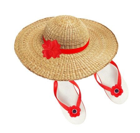 white beach shoes with red flower and woman hat isolated on white photo