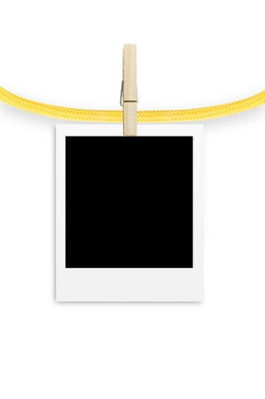 photo frame with clothespin isolated on white background photo