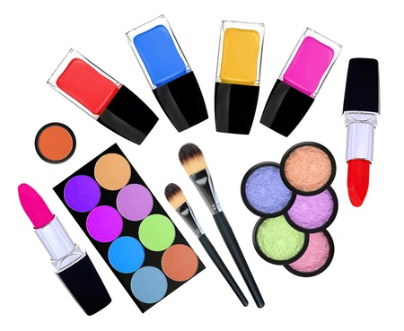 set of 5 eyeshadows, brushes, lipsticks and nailpolishes isolated on white photo