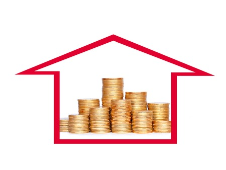 Many coins in column in house. Financial concept. photo
