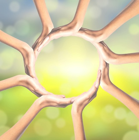 Human hands making circle on bright background photo