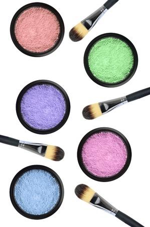 set of 5 eyeshadows and brushes isolated on white background photo