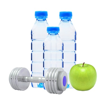 Blue bottles with water, chromed fitness dumbbells and green apple photo