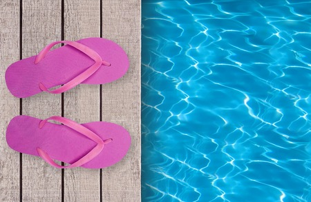 swimming shoes: Swimming pool, wooden deck and pink beach shoes
