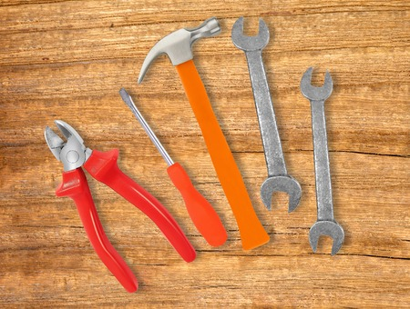 wrenches: Hammer, screwdriver and wrenches over wooden background
