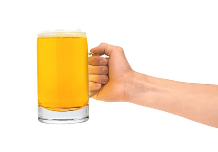 Glass of beer in man hand isolated on white background photo