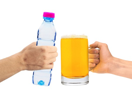 unhealth: Human hands holding a bottle of water and beer glass isolated on white