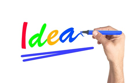Hand writing colorful word Idea on transparent board photo