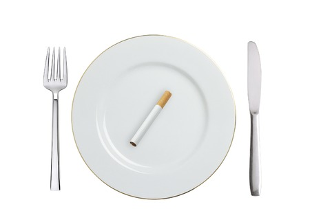 cigarette on white plate isolated on white background photo