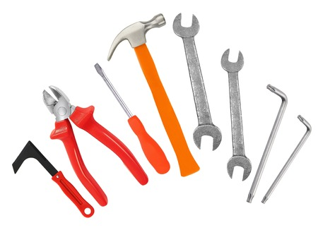 Hammer, screwdriver and wrenches isolated on white background photo