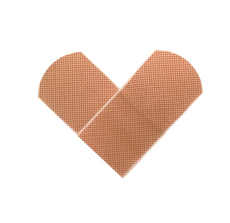 Medical patch as heart symbol isolated on white background photo