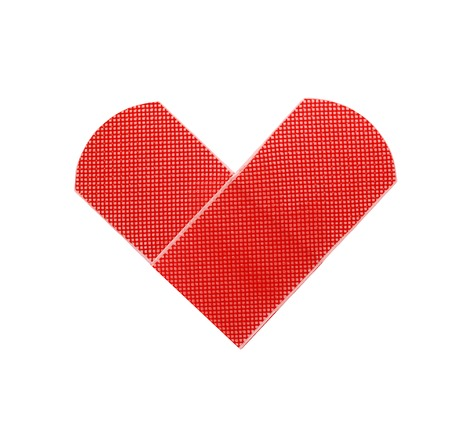 Medical patch as heart symbol isolated on white background