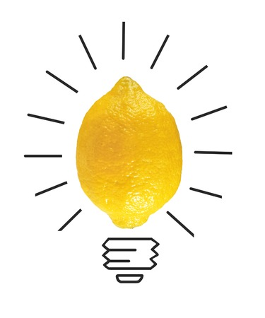 crumpled paper ball: Inspiration concept yellow lemon as light bulb metaphor for good idea Stock Photo