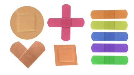 Colorful medical patches isolated on white photo
