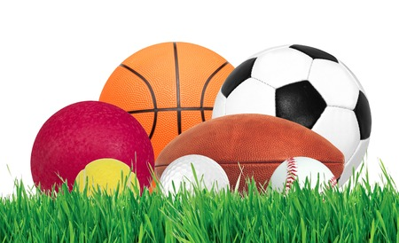 traditional sport: Sports balls over green grass isolated on white background