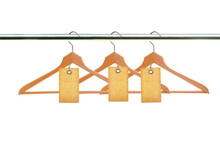 closet rod: wooden clothes hangers with blank tags isolated on white background
