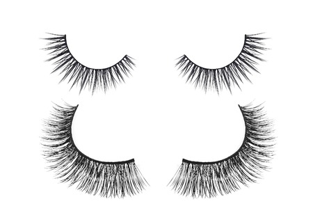 Black false eyelash isolated on white background photo