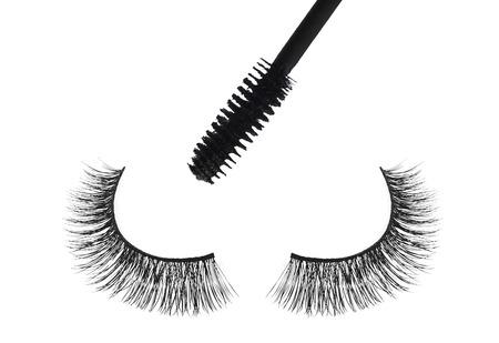 false eyelash: Black false eyelash and mascara isolated on white background