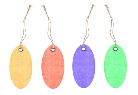 sew tags: Colorful tags with metal rivets isolated on white Stock Photo