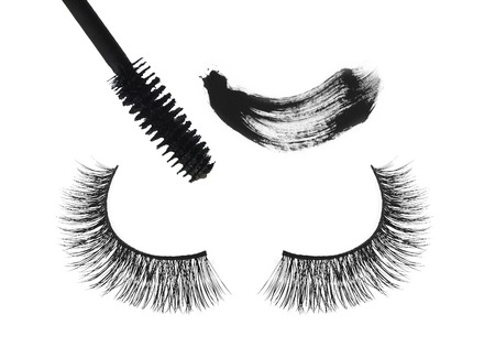 Black false eyelash and mascara isolated on white background photo