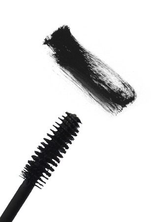 touch base: Black mascara brush stroke isolated on white