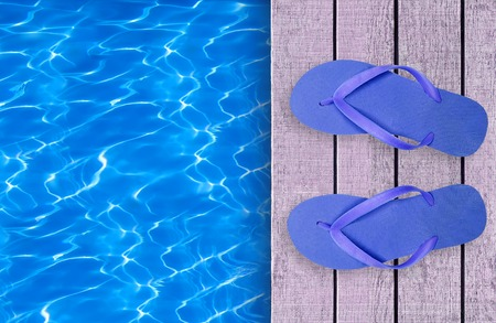 swimming shoes: Swimming pool, wooden deck and blue beach shoes