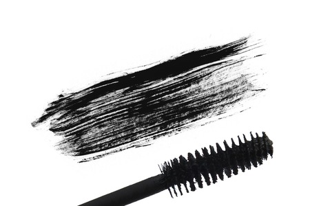 touch base: Stroke (sample) of black mascara, isolated on white macro