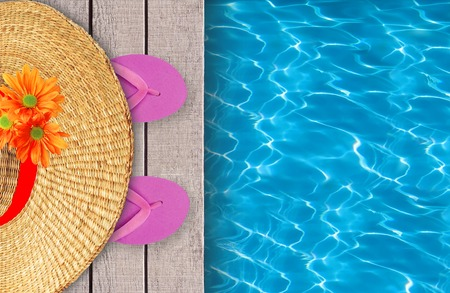 swimming shoes: Swimming pool, wooden deck and pink beach shoes with hat