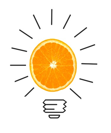 crumpled paper ball: Inspiration concept of orange as light bulb metaphor for good idea Stock Photo
