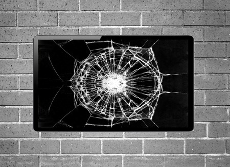 plazma: Blank screen LCD tv with broken screen hanging on a wall