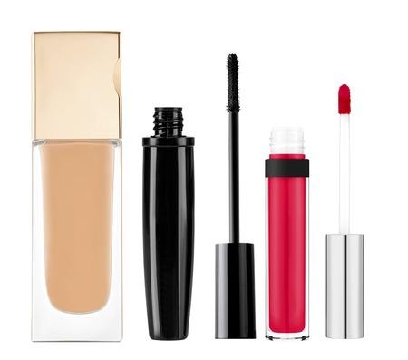 foundation, mascara, lip gloss isolated on white background photo