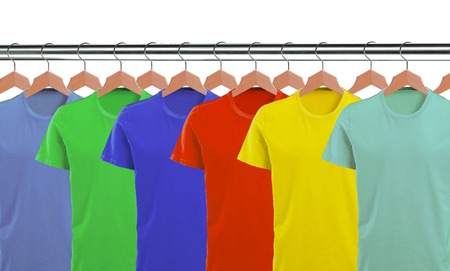 lots: Lots of T-shirts on hangers isolated on white background