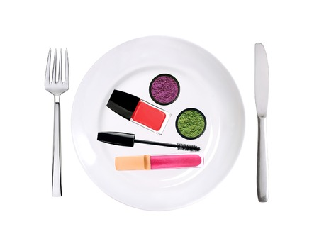 many cosmetics on white plate isolated on white background photo
