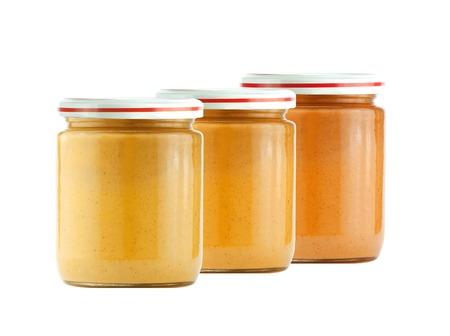 pureed: Jars of baby puree isolated on white Stock Photo