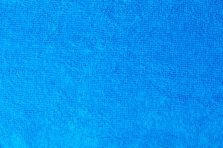 textura: Texture of a blue cotton towel as a background