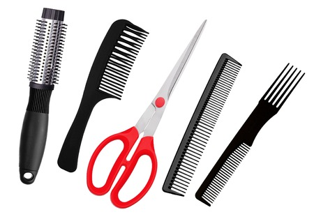 clippers comb: Red scissors and combs isolated on white background