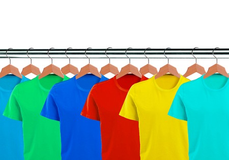 lots of: Lots of T-shirts on hangers isolated on white background